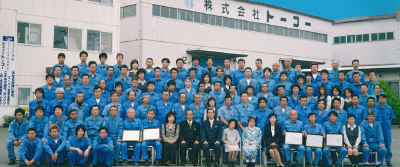 Group photo of employees commemorating the company's 60th anniversary